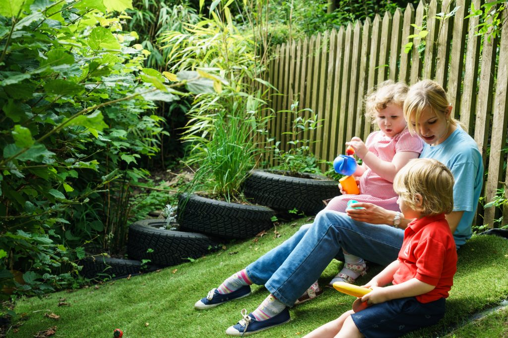 Family enjoying artificial grass